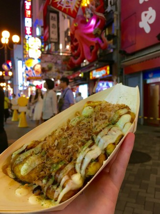 Takoyaki - battered and fried octopus and then covered in takoyaki sauce, mayo and shavings of dried bonito. Try this in Osaka!